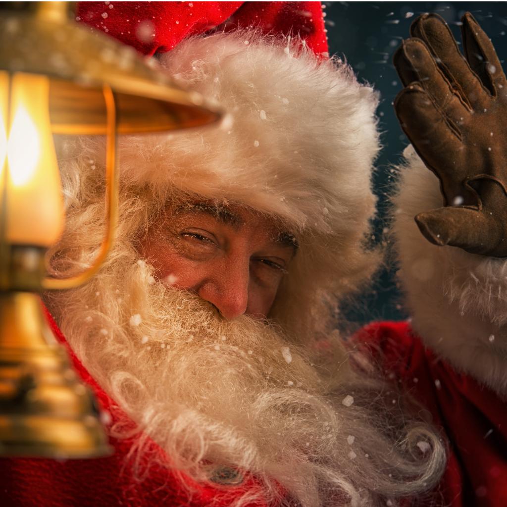 Father Christmas waving and holding sack on his back
